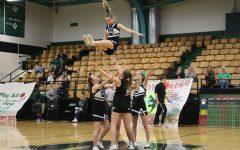 Cheerleaders ignite spirit in light of Courtwarming basketball game