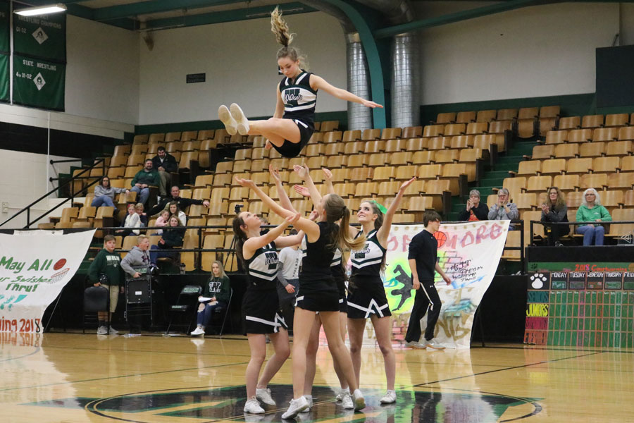 Warsaw cheerleaders perform their first stunt indoors for the Courtwarming assembly. The cheerleaders hosted many performances during the assembly held on Feb 2.