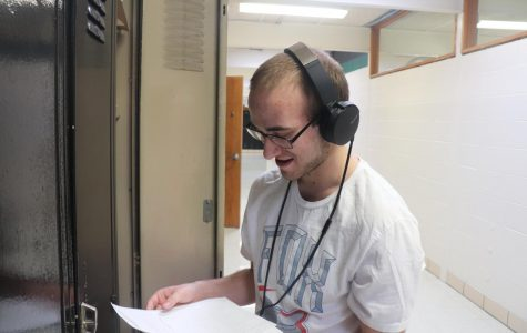 """Senior Eric Meldrum gets rid of leftover math homework and listens to Tech N9ne. Meldrum is usually never seen without his headphones. """"I listen to music twenty-four seven."""" He said."""