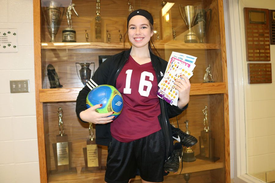 Junior Kamryn Yach dresses as an athlete for Thursday's spirit week theme. As part of her campaign as a Courtwarming princess candidate, Yach spent her day handing out complimentary stickers.