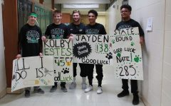 Wrestlers walk the halls as they head for state