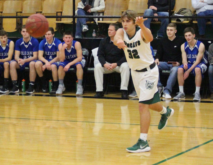 Keegan Glenn passes the ball to teammate. Playing on their home court, the boys played against Cole Camp.