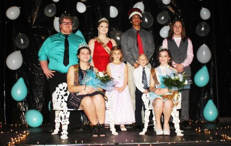 Senior king and queen Logan Neth and  Zoe Eledge and junior prince and princess, Chance Thirstrup and Autumn Long celebrate in the spotlight as Echoes Ball royalty. Graduates Makayla Mais and Wesley Carr, with the help of flower girl Addison Young and crown bearer Connor Roberts, awarded the royalty. Photo submitted