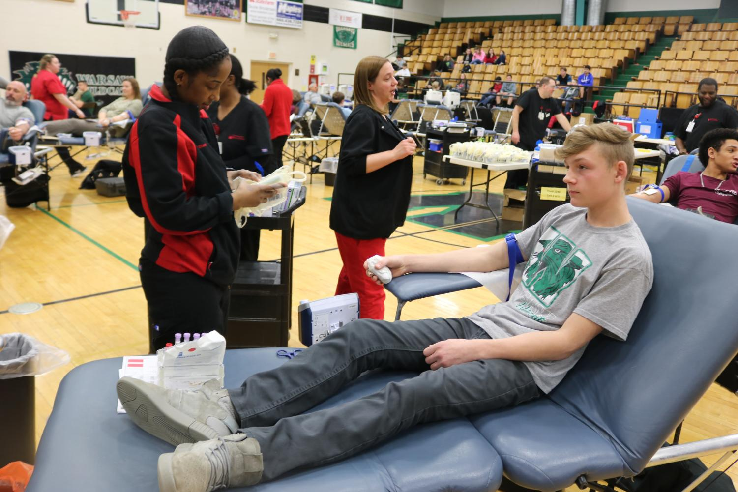 "Sophomore Jesse Barckley prepares to donate blood for the first time on the 13th. ""I could feel the blood being sucked out of my arm. I was worried about air being pumped into my vein,""Barckley said."