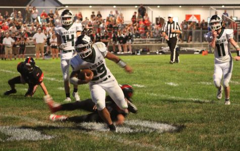 Senior Kieon Davis runs the ball toward the in-zone after an unsuccessful tackle by Sherwood's defense. The game was held on Sept. 14