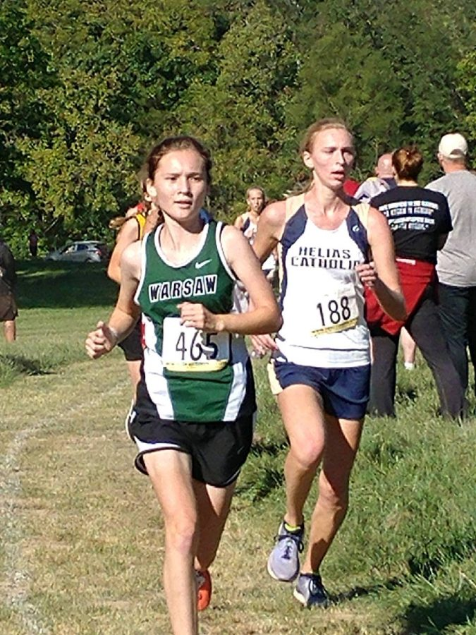 Freshman+Alyssa+Alcantara+pushes+through+her+race+at+Hermitage+on+Sept.+22.+Alcantara+won+first+place+in+the+conference+meet+at+Buffalo+with+a+time+of+21%3A21.39.+