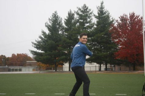 Sophomore Bradley Brown rears his arm back, preparing to drive a disc across the football field. Brown