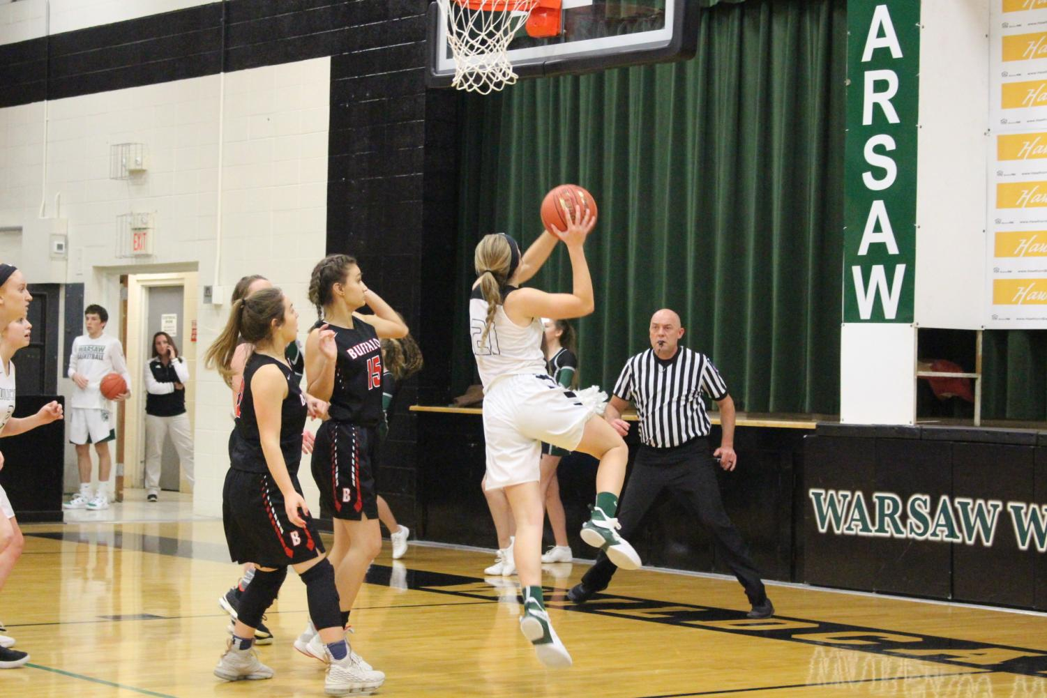 Junior Aubrie McRoberts goes up for a lay up against Buffalo during the Warsaw Tournament. The team's record is 6-11. Photo by Rylee Pals.