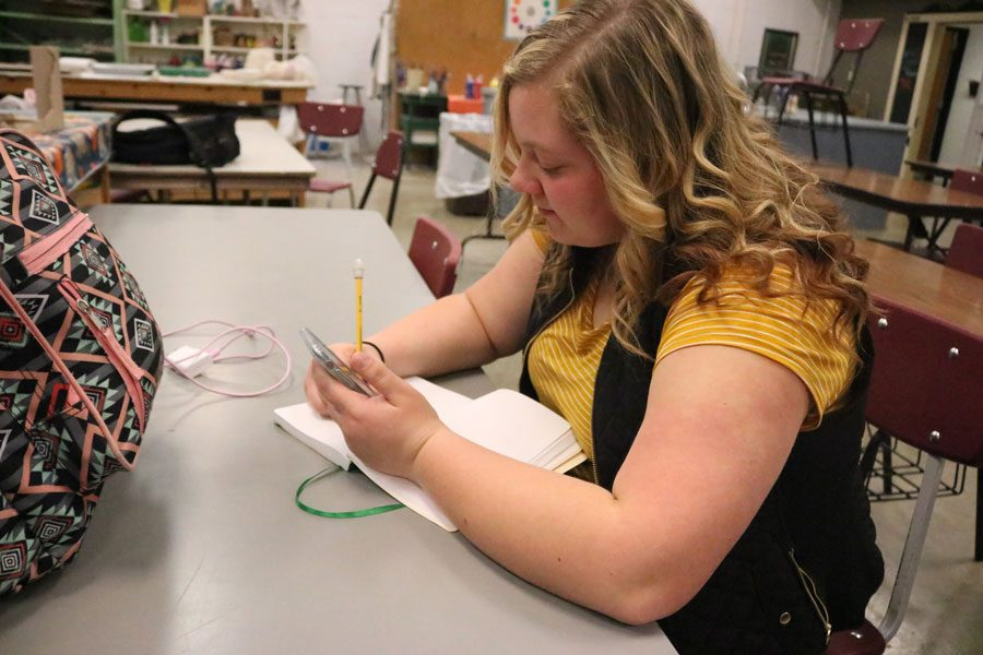 Senior Megan Mantonya sketches an image from her phone during her Drawing and Painting class. Mantonya has plans to study art education after she graduates high school.