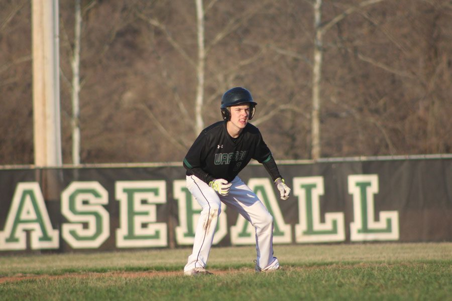 Junior Riley Jelinek watches for a chance to advance to the next base.