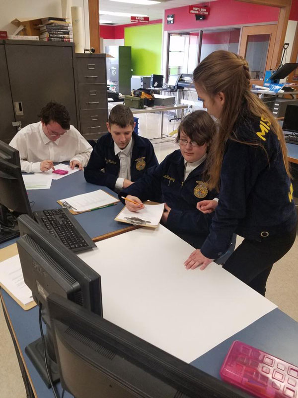 The food science team, sophomores Dennis Harrison, Derek Maddux, Luke Rasberry and Kyleigh Hines, compete at a contest.