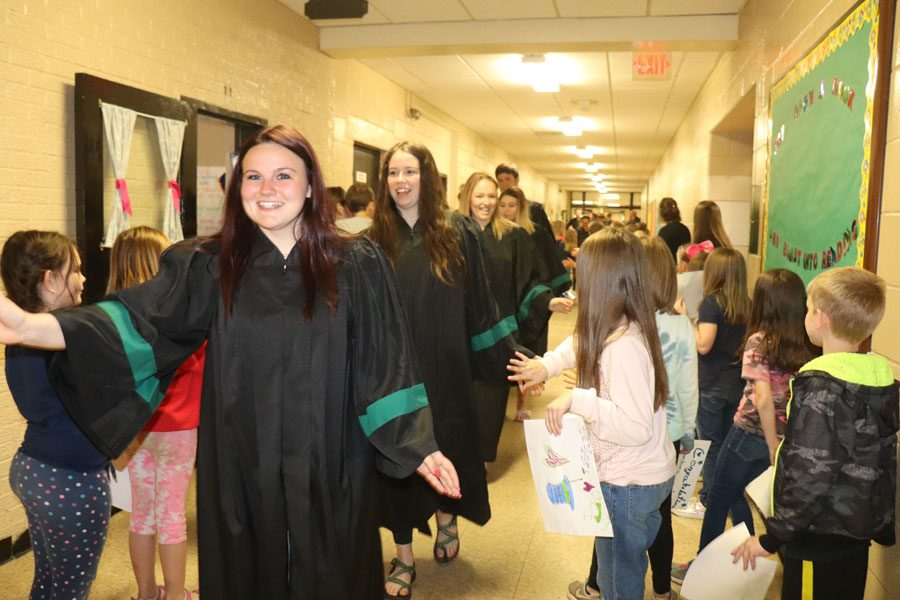 Brandi Hubert, Kamryn Yach, Taylor Bunch, Chloe Lux and Colby Schwartz walk through North Elementary on May 13. They all attended North.