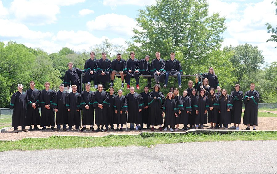 Senior graduates gather for a group photo around the monkey bars at North Elementary school.