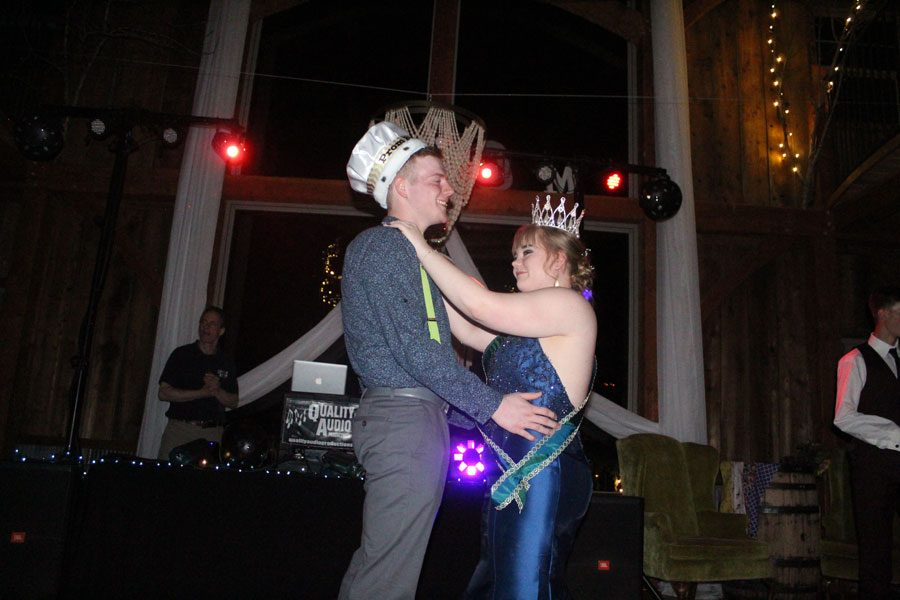 Prom night royalty, Caleb Greene and Ren Rozzel dance together after being crowned. Both candidates had no expectation of winning but were very joyful when they did.