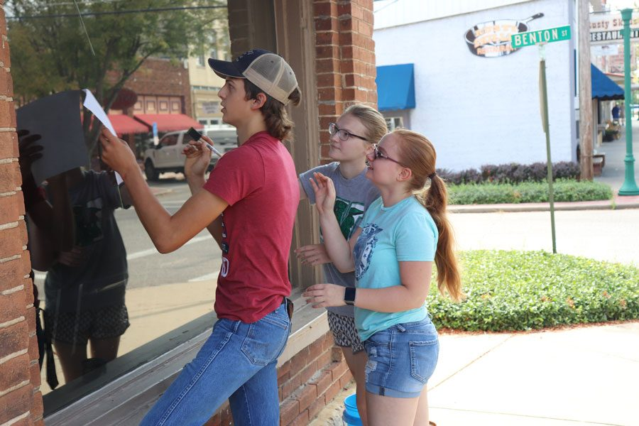 Junior Class Student Council paints windows in downtown Warsaw. The juniors raised money for the 2019 Prom.