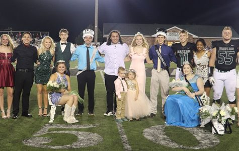 The 2019 Homecoming court celebrates 2019 Homecoming at coronation. They include (front row) junior Princess Kylee Fajen, crownbearer Brox Boyer and flower girl Josie Parker, senior Queen Allyssa Gemes; (back row) juniors Rheanna Coke, Logan Strunk, Brooke Spry, Austin Brazel, Aspen Whitaker, Trey Palmer, Prince Joe Montez, 2019 graduates Elijah Hawkins and Jessie Glenn, senior King Lerran Yoder, Zach Chapman, Kya Schepker, Lane Bates, Payge Adair, Matt Couzens and Rayni Simons.