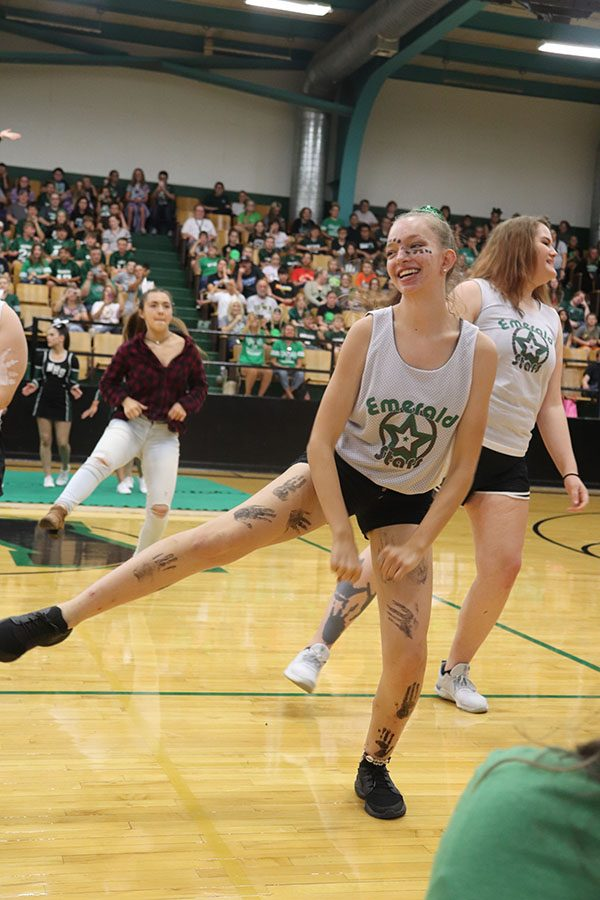 """Senior Alexus Brown and sophomore Brea Jolliff, members of the Emerald Stars Dance Team, dance to """"The Git Up"""" by Blanco Brown at the Homecoming Assembly on Sept. 20. The Emerald Stars Dance Team was created at the end of the 2018-19 school year."""