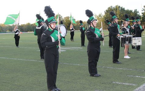 Marching band, color guard, dance prepare for entertainment, competition