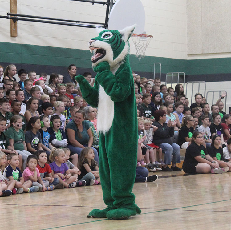 Wally the Wildcat hypes up the elementary students during one of the Homecoming Mini-Assemblies.