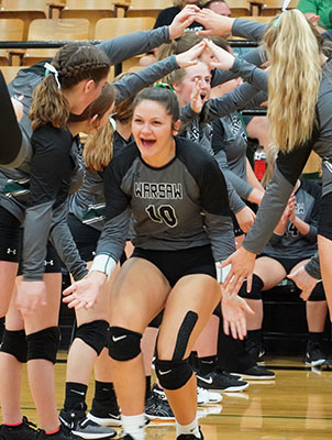 Senior Ally Wenberg take ones of her last starting line up run-outs. Warsaw took the fall to Eldorado Springs.