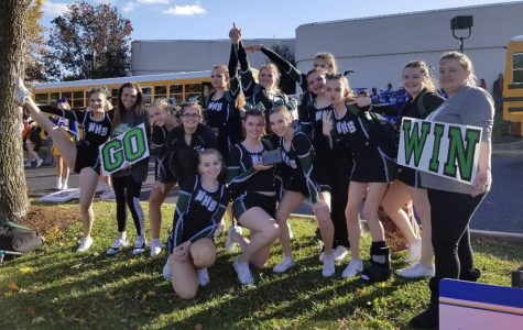 Cheerleaders practice hard, win chance to compete at state