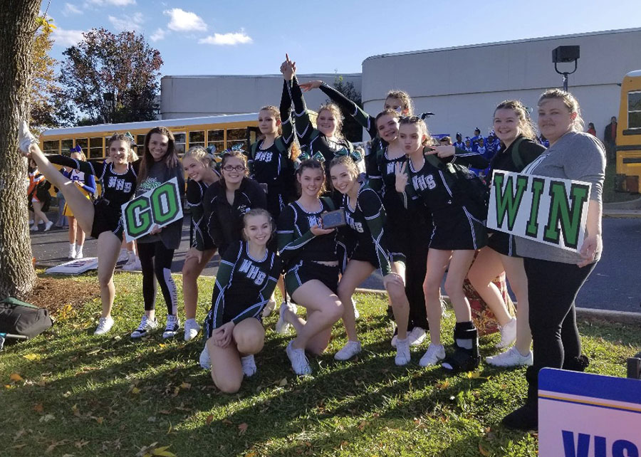 "The Warsaw Cheer squad, (front row) juniors Darby Mostaffa, Cassidy Parks, Hallie Wenberg, Haley Dwyer, sophomore Natalie Johnson, junior Morgan Branson, head cheer coach Holly Helms, (back row) freshman Emma MacWilliam, assistant cheer coach Kelly Wenberg, seniors Andrea Merritt, Aubri Umlauf, juniors Ariel Givens, Jamie Jorgensen and sophomore Jolina Givens, qualified as a group for All-American Cheer during their cheer camp. ""The girls have been doing lots of different fund raisers [to attend Orlando for All-American Cheer,] from garage sales to painting faces at Heritage Days; some of them are setting up GoFundMe accounts, whatever they can because it costs a lot to go down there,"" Helms said."