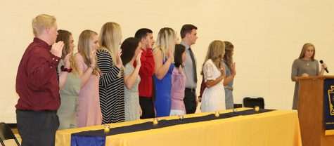 New NHS members are sworn in be sehnior Aubrie McRoberts at the induction ceremory on Sept 25. They included: joniors Logan Strunk, Taylor Spry, Lauren Kreisel, Emmaleigh Kowal, senior Wade Henderson, Kiesten Grobe and junior Kylee Fajen.