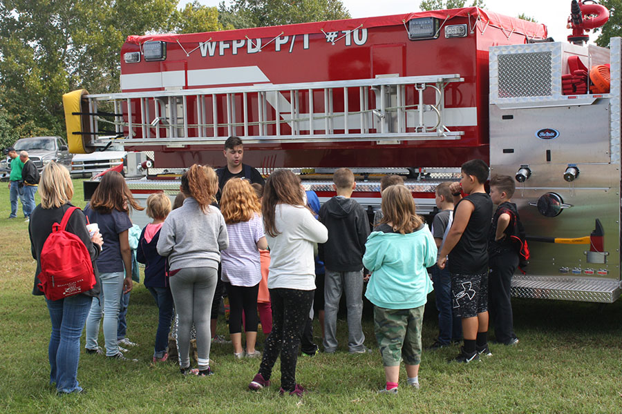 Senior Cody Lock talks to North School kids about fire safety. Lock is a volunteer fire fighter for Warsaw.