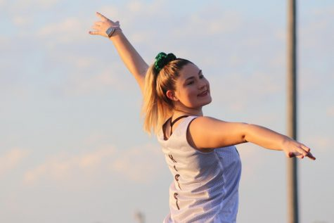 Lauren Kreisel dances at a home football game during the pregame show. The dance team performed with a different dance before every home game during football season.
