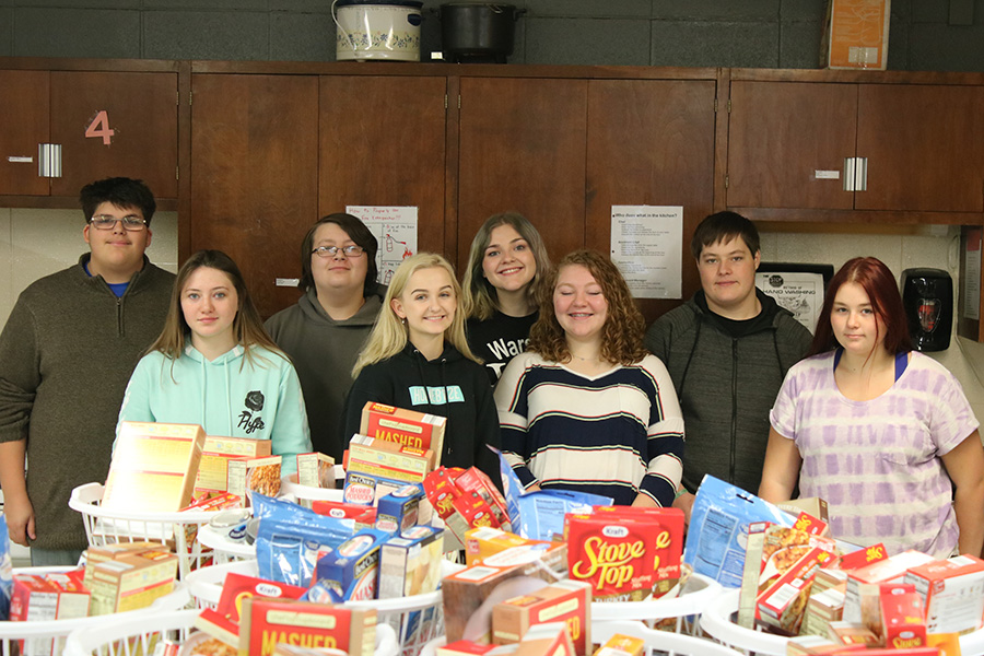 Students prepare to pack Thanksgiving food drive baskets. They included: (front row) sophomore Breanna Winfrey, juniors Lily Waller, Arianna Herrick and Izabelle Reed; (back row) sophomore Benjamin Kowal, junior Luke Rasberry, senior Mackenzie Gemes and junior Cody Lytton.