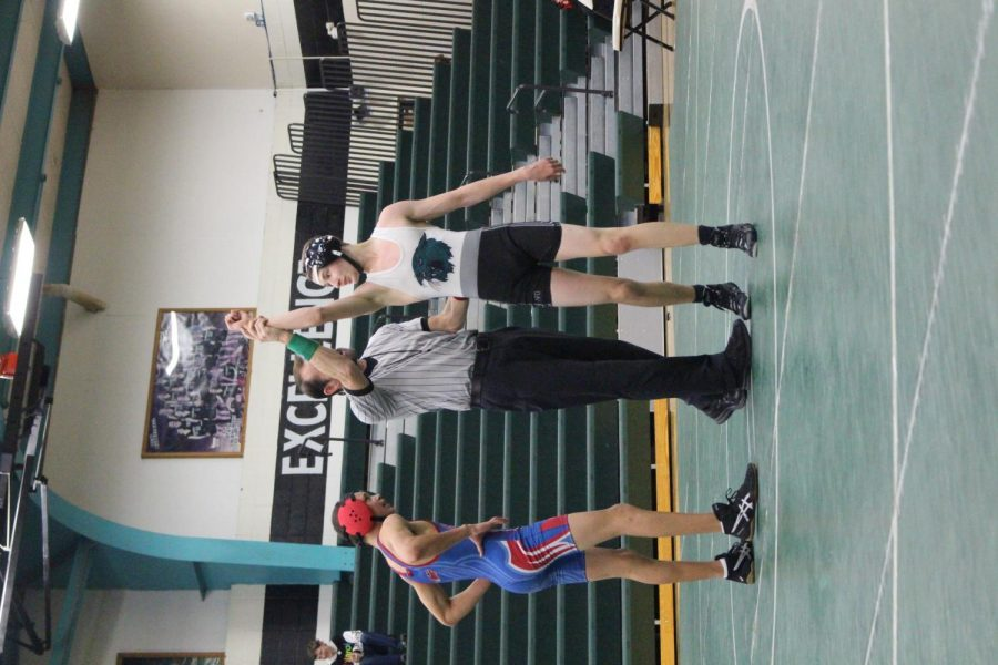 Warsaw High School student Westin Archer winning wrestling match against a Clinton Wrestler
