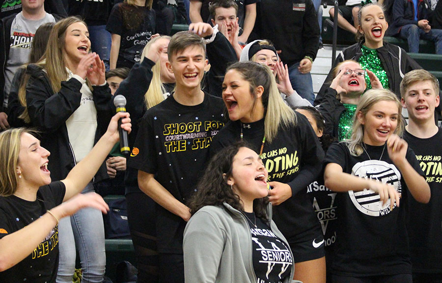 "Seniors (front row) Aubrie McRoberts, Lily Tyler, (middle row) Alexis Mantonya, Parker Love, Ally Wenberg, Rayni Simmons, Grayson Gregrich, (back row) Becky Petesch and Alexis Brown scream and shout at the Courtwarming Assembly during the cheerleaders' chant to ""boogie down."" The Courtwarming assembly was held on Feb. 7."