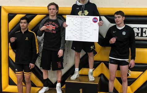 Senior Patrick Surrell celebrates his state qualifying performance at the district tournament on Friday, Feb 14. He took third place in his respective weight class (138).