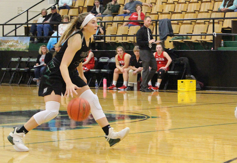 Senior Aubrie McRoberts dribbles the ball down the court. McRoberts has a big leadership role on the team as the only senior.