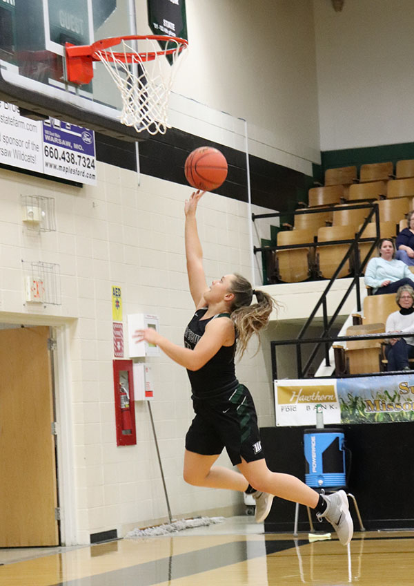 Sophomore Taylor Howe shoots a  layup. Howe plays as a point guard for the team.