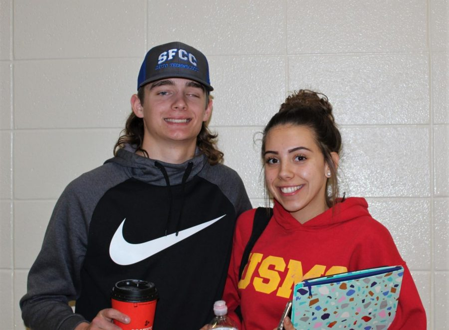 Seniors Ashten Cunningham and Chase Steiner pose together while walking in the halls. Cunningham and Steiner lived on their own together, during high school.