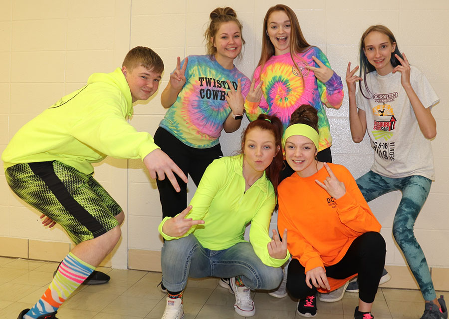 "Sophomores (front row) Dakota Steinhoff, Kaylee Lawson, Natalie Johnson, (back row) Nora McMillin, Julie Long and Nicole Say show off their vibrant colors for Neon Day during the 2020 Courtwarming spirit week. The theme for Courtwarming was ""Shooting for the Stars."""