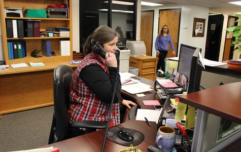"Administrative assistant Cindy Murrell helps a caller who contacted the high school office. ""I had never been a 'secretary' before accepting this position,"" Murrell said, ""but I had office management, public relations experience, planning and organizational skills from my previous jobs. """