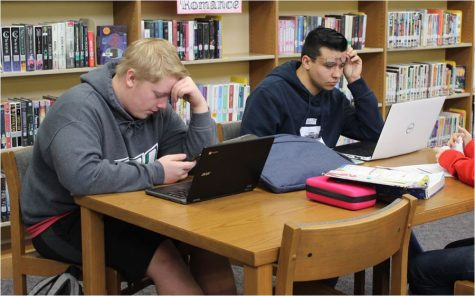 Juniors Logan Struck and Seth Huffman, work on online classes in the library media room. Both Strunck and Huffman have taken dual credit classes during fall semester.