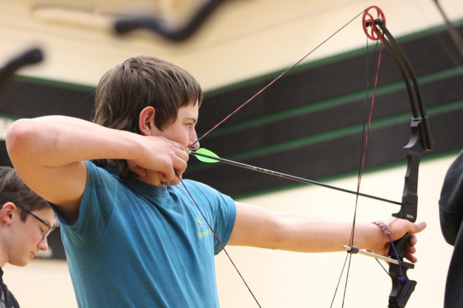 Freshman Trevor Downing aims at the target during the Benton/Hickory Country shoot held at the Warsaw Middle School on Feb. 28th