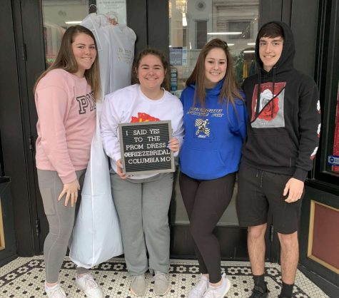 Senior Taylor Spry celebrates with her sister freshman Ashley Spry, junior Lea Mebruer and freshman George Montez after choosing her dress for the 2020 prom. Spry, along with many other students, purchased her dress for the event months in advance.