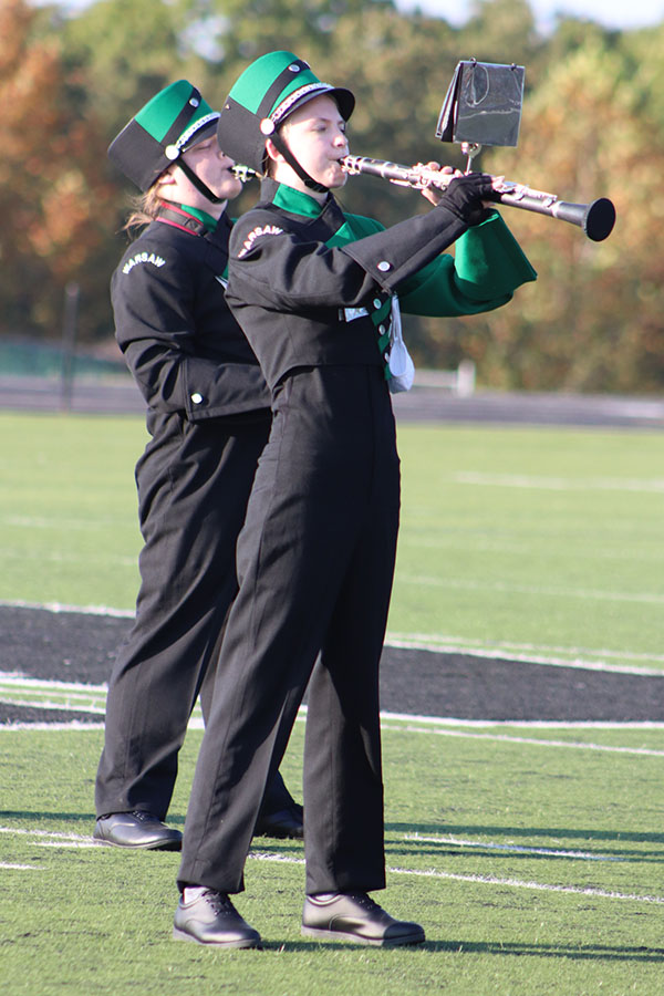 Sophomore Brieanna  Fenlon plays the clarinet during the Sept. 25 band  rehearsal. The band placed fourth for their show on Sept. 26 at the Wright City Marching Festival.