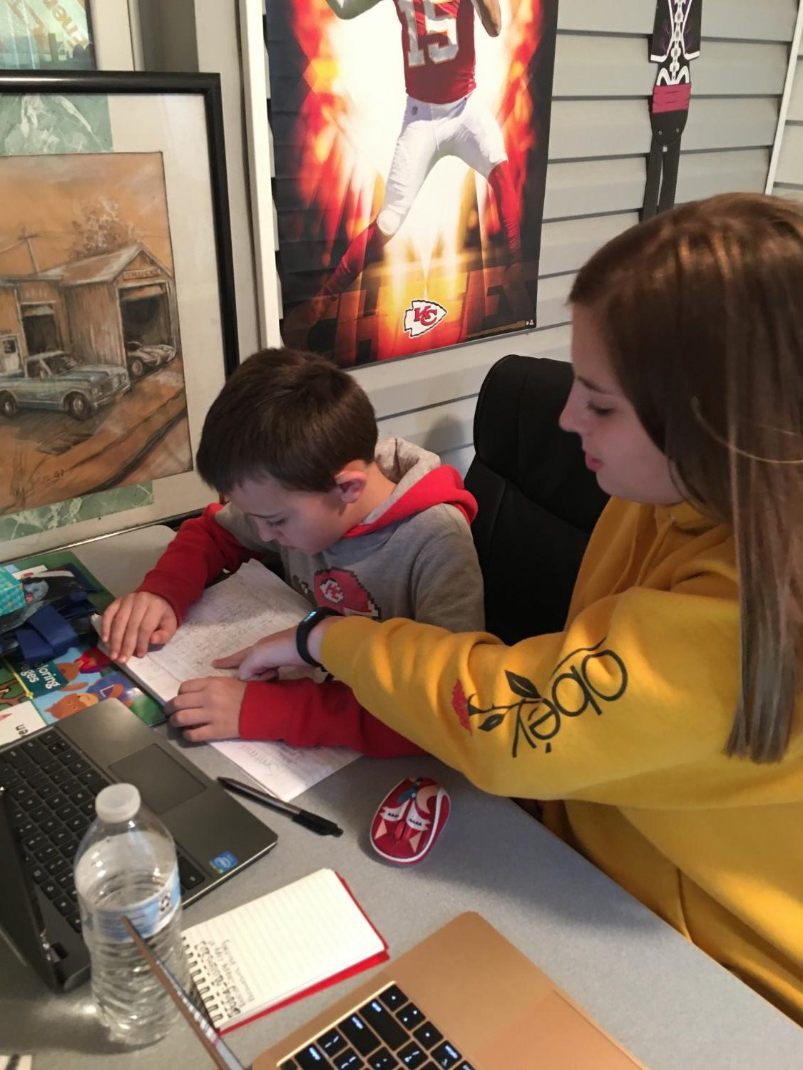 Sophomore Perrie Judd and fourth grader Marshall Judd work on their assignments for Launch. Perrie Judd joined the Launch program to protect her family.