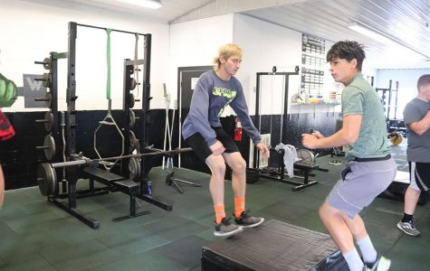 Seniors Zach Sharp and Justin Martin practice box jumps in weights class. Sharp is perfecting his skills for football season