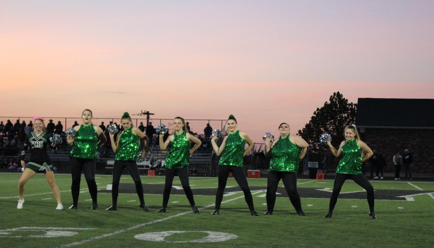 The Emerald Stars (juniors Kaylee Lawson, Brea Jolliff and Jolina Givens, seniors Ariel Givens, Lauren Kreisel and Sabrina Uptgraft and sophomore Lilia Jensen) dance at the Oct. 16 Homecoming game during the pregame show.  The dance team also performed on the sideline during the game.