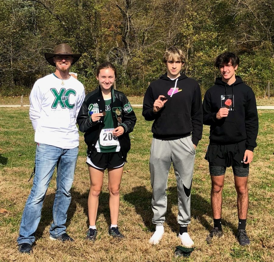 Cross+Country+head+coach+Ehren+Banfield%2C+junior+Alyssa+Alcantara%2C+senior+Trey+Palmer+and+sophomore+George+Montez+gather+for+a+celebratory+photo+after+qualifying+for+state+at+the+Hermitage+District+meet+on+Oct.+31.+Alcantara+placed+sixth%2C+Palmer+placed+fifth+and+Montez+placed+sixth.+All+three+will+be+running+at+the+state+meet+on+Nov.+5+in+Columbia.