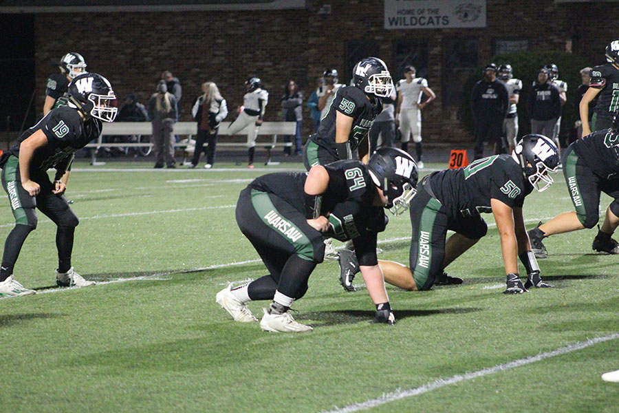 Senior linemen Logan Strunk and Timothy Burkhart set up and prepare to block against the Skyline Tigers at the home game on Oct. 16. Strunk and Burkhart have played football for four years.