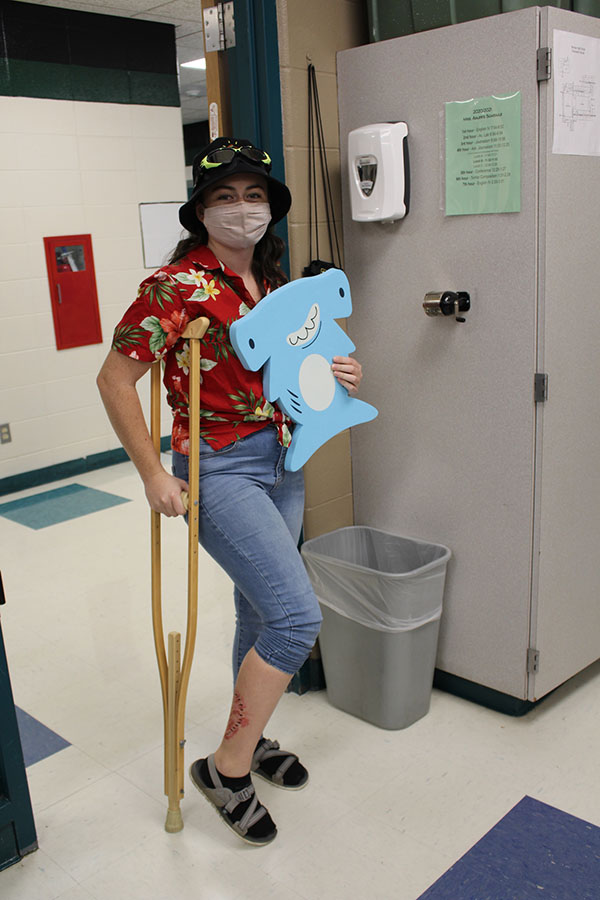 "Senior Gabrielle Porter dresses as a tourist for ""Where would you rather be?"" day during the Homecoming spirit week. The theme for spirit week was COVID Chaos and each day was in relation to the pandemic."