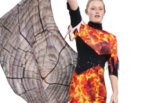 """Sophomore Samantha Pearman performs part of her flag routine during the first movement of the marching band's field show titled """"Elements of Fire."""" Pearman will be taking over as the captain of the color guard team for the 2021-2022 school year."""