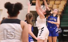 Sophomore Ellie Murrell drives into the paint to score against Cole Camp. Warsaw beat Cole camp to 57-35 in the Warsaw tournament.